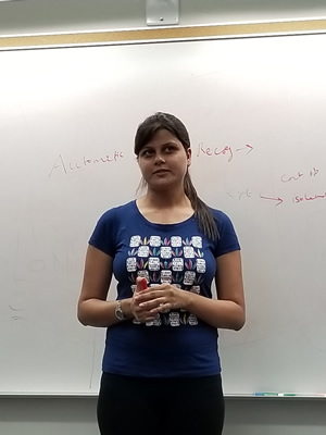 Laxmi P pauses to answer a student's question about speech recognition.
